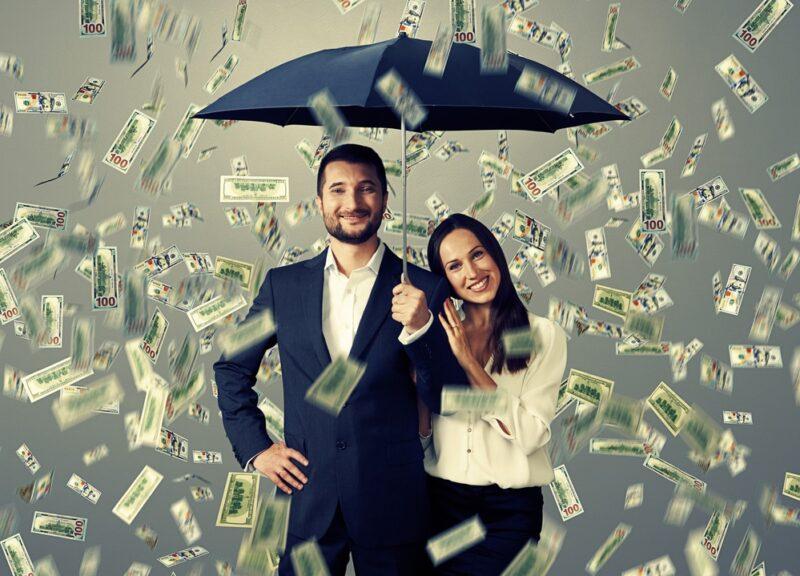 raining money on couple